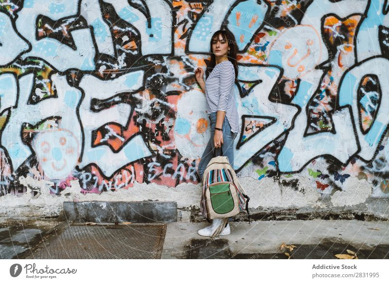Casual girl with backpack at street Human being Easygoing Posture Self-confident Style Accessory Backpack Traveling Graffiti Youth (Young adults) Town
