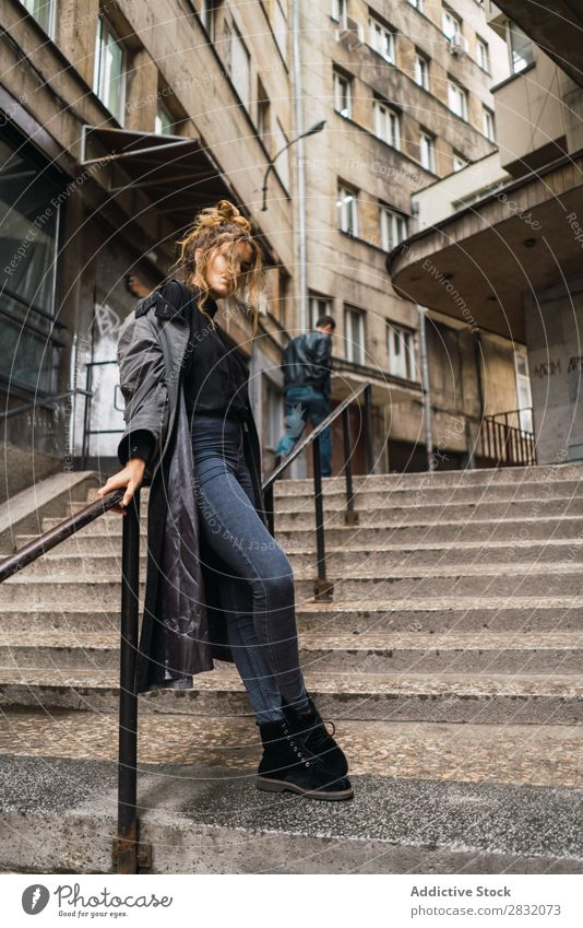 Trendy girl posing on stairs Woman Style Posture Grunge Street Town Stairs Self-confident covering face Relaxation Beauty Photography Hip & trendy City Model