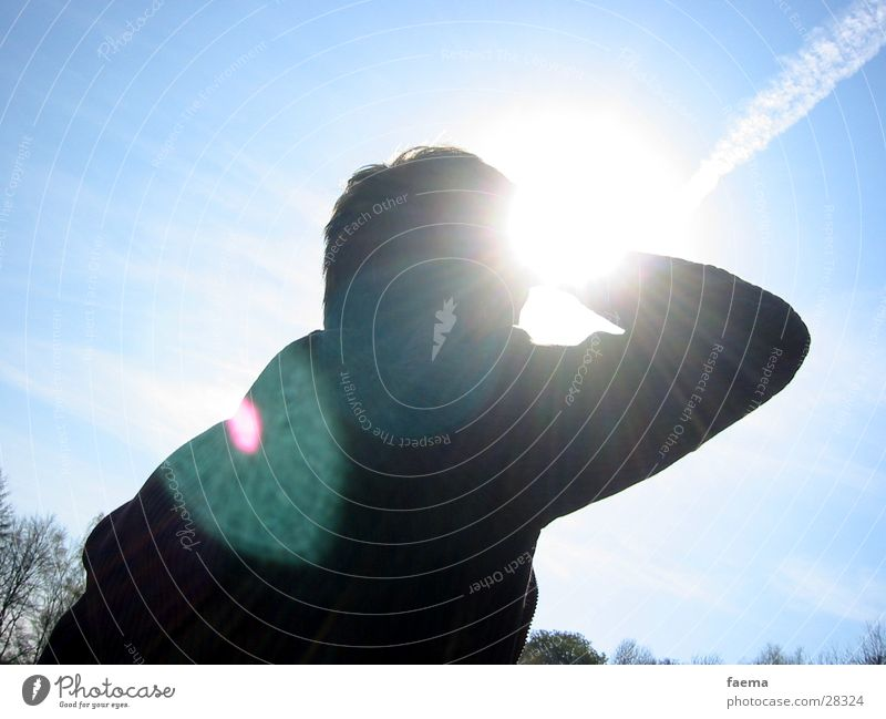 Sky Man Blue Vacation & Travel Sun Relaxation Far-off places Lighting Vantage point Lens flare Patch of light