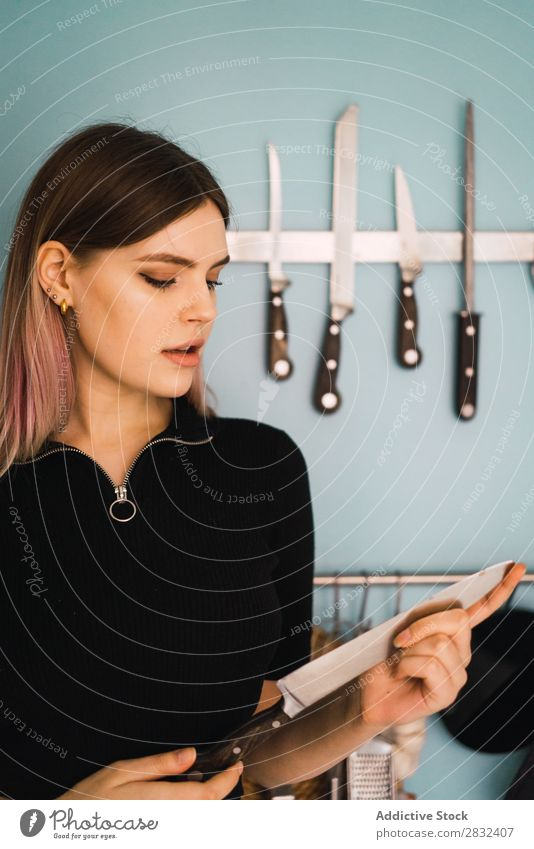 Young woman with kitchen knife Woman pretty Home Youth (Young adults) To enjoy Knives Kitchen Attractive Posture Portrait photograph Beautiful Lifestyle