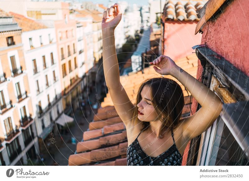 Content model grimacing on balcony Woman Cheerful romantic Happiness Grimace Skyline Balcony Terrace Posture Expression Beauty Photography Youth (Young adults)