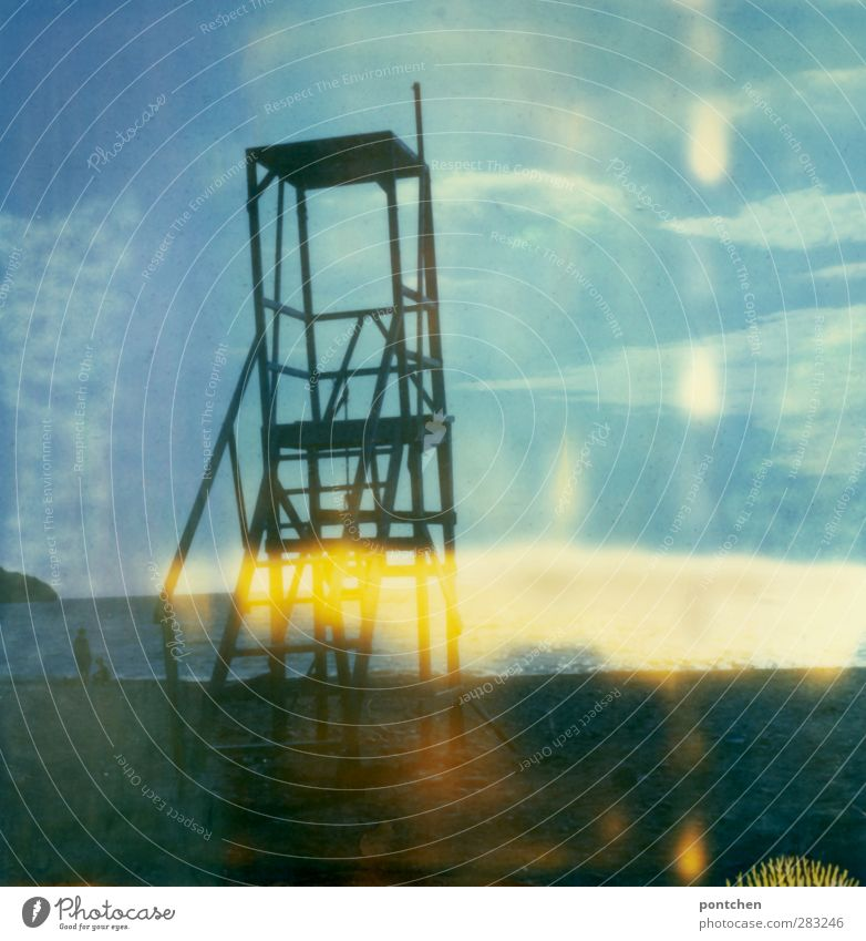 Polaroid. Surveillance tower on the beach. Man with dog looking at the sea. Security, freedom, recreation Beach Crete Manmade structures Blue To go for a walk