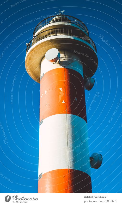 Colorful lighthouse on blue sky Lighthouse Tower Sky Multicoloured Coast Architecture Vacation & Travel Navigation Red White Nature Landscape Safety