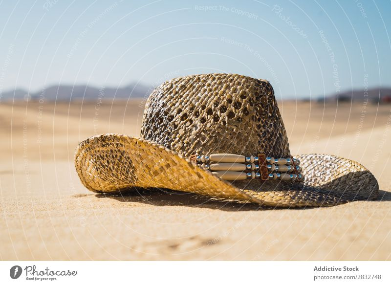 Straw hat on sand Sand Hat Cowboy Coast Vacation & Travel Beach enjoyment Compose Nature Headwear Resort Summer Leisure and hobbies Sunlight Dry Freedom