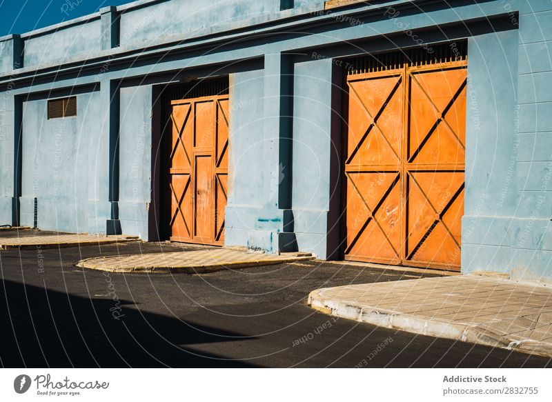 Orange gates in blue wall Exterior Gate Metal Building Consistency Wall (building) Multicoloured Entrance Colour House (Residential Structure) Bright Day