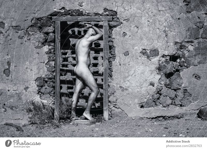 Nude man in doorway of ruined house Man Naked Body Ruin House (Residential Structure) Desert Black & white photo Sun Stand Masculine pose desolated Natural Skin