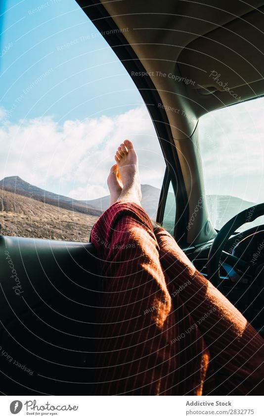 Crop man relaxing in car while traveling Man Car Landscape Window Feet Relaxation Transport Freedom Barefoot Legs Adventure Leisure and hobbies Stick out Lounge