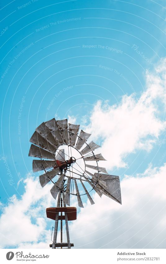 Rusty windmill on blue sky Windmill Old Metal Sky Agriculture Landscape Spin Energy Mill Rotation Nature Power Environment Rural Clouds Ranch Alternative