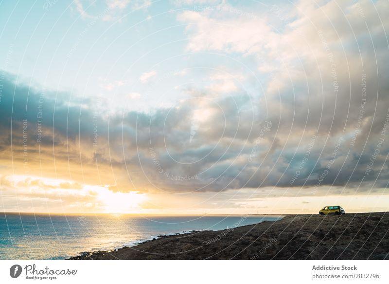 View of shoreline of ocean Coast Panorama (Format) Ocean Pebble Scene Wild Peaceful Landscape seascape Beach Remote Clouds Sky Tourism Natural scenery seaside