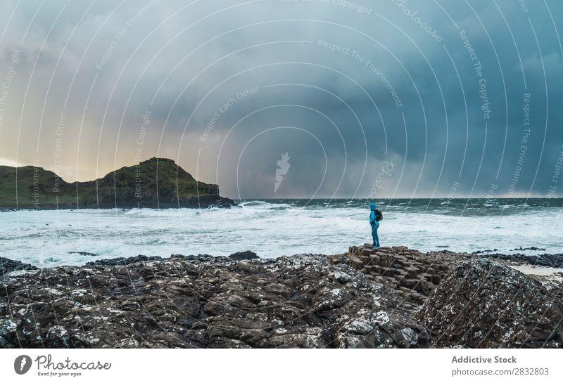 Tourist standing at wavy ocean Coast Rock Ocean Landscape Vacation & Travel Stand Beach