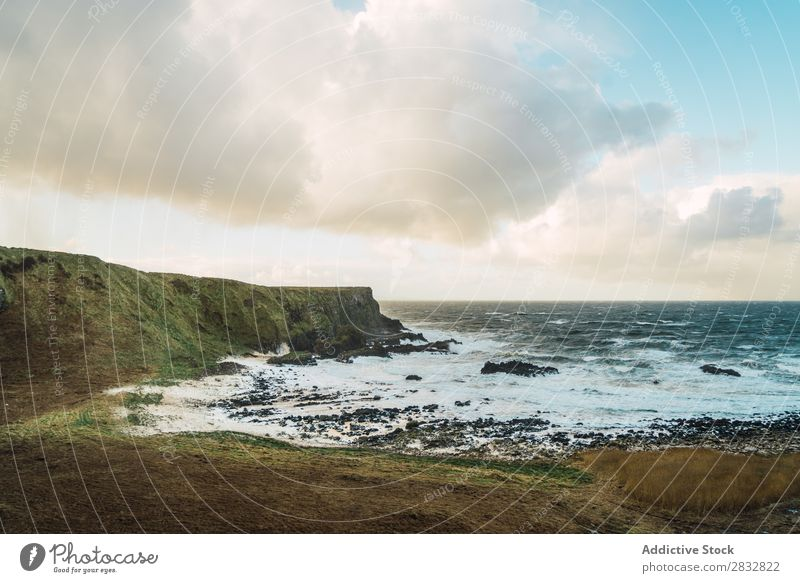 Coastal rocks and wavy ocean seaside Rock Ocean Landscape Beach Nature Water Natural seascape Stone Beautiful Northern Ireland Vacation & Travel Sunbeam Cliff