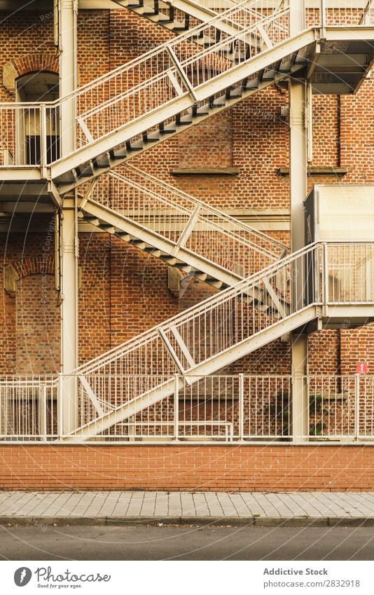 Fire stairs of building exterior Building Exterior Stairs Escape Architecture Design Emergency Structures and shapes Side Town Downtown Street Safety Brick wall