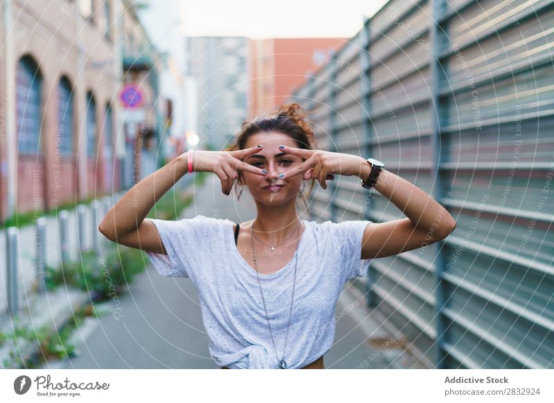 Stylish expressive girl posing at street Woman Style Playful Street gesturing Youth (Young adults) Vacation & Travel Indicate Town Cheerful Happiness Posture