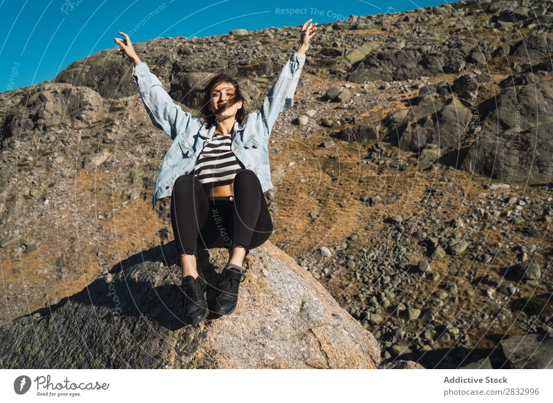 Woman sitting on stone in a rocky slope Rock Slope Nature Sunbeam Beautiful Attractive pretty Youth (Young adults) Thin Vacation & Travel Delightful Cute Day