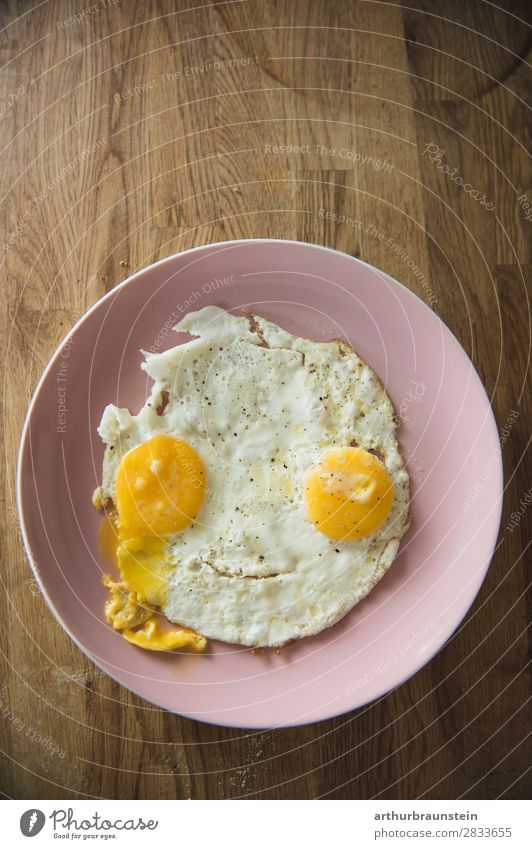Fried egg face on wood Food Egg Fried egg sunny-side up Nutrition Breakfast Organic produce Vegetarian diet Slow food Crockery Plate Shopping Healthy