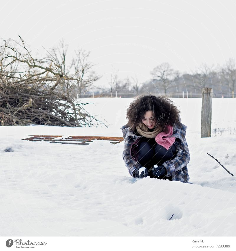 The first snow 1 Human being Nature Landscape Winter Snow Field Coat Scarf Gloves Hair and hairstyles Brunette Long-haired Curl Crouch Playing Authentic
