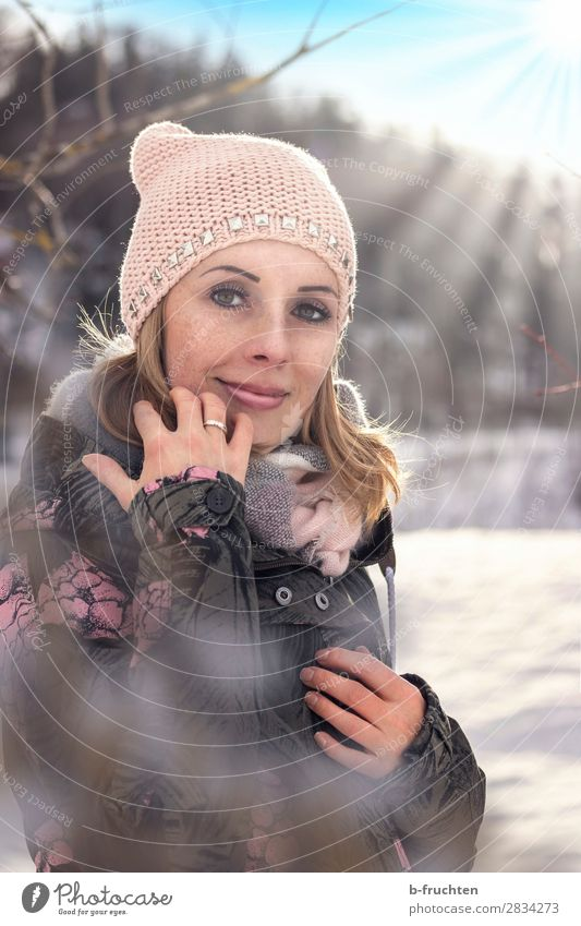 Woman with cap and scarf, outdoor portrait in winter Well-being Leisure and hobbies Adults Face 30 - 45 years Sunlight Winter Beautiful weather Snow Park Forest