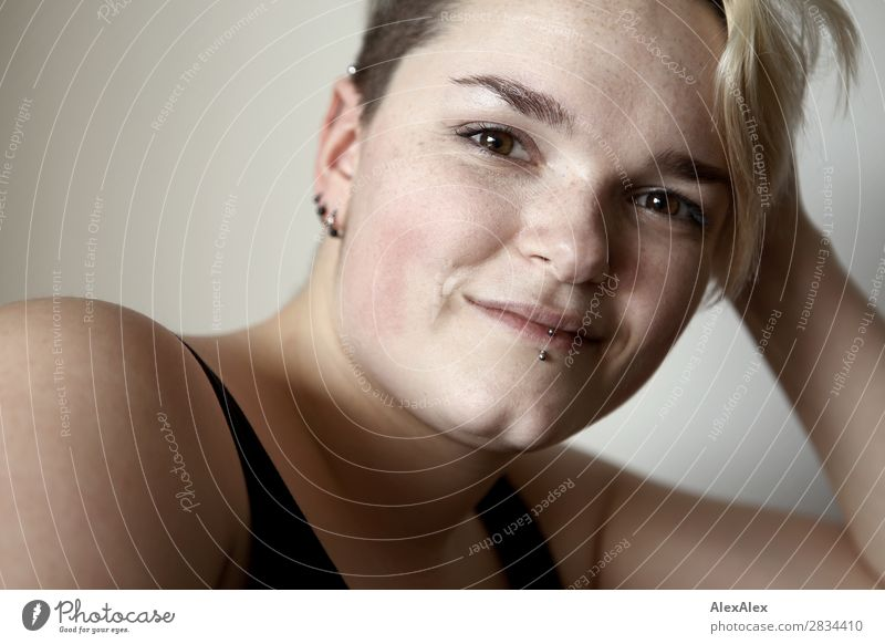 Portrait of smiling young woman with freckles and dimples Style Joy pretty Skin Life Young woman Youth (Young adults) Face pit 18 - 30 years Adults Piercing