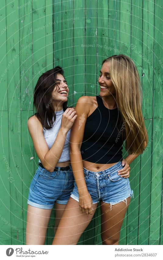 Cheerful women at wooden wall Woman Joy Friendship Together Human being Youth (Young adults) Lifestyle Vacation & Travel embracing Smiling Laughter Happiness