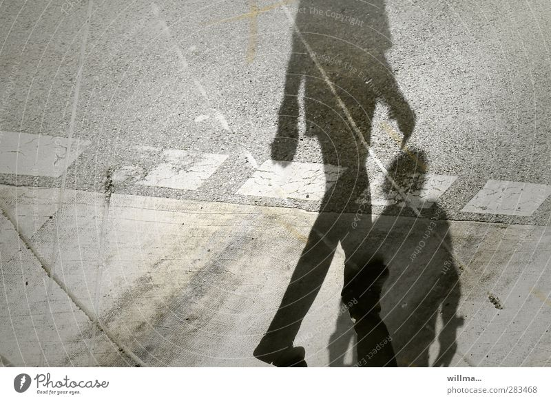 Shadows of two people on the street - feeling ignored Identity Argument Discordant Shadow play Dark side Shadowy existence Tracks Ignore Walking Encounter