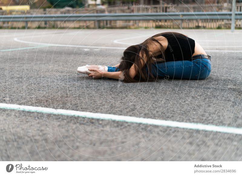 Woman lying on a playground Ballet Dance Lie (Untruth) Ground Asphalt pose Playground Street Conceptual design City Town Girl Dancer Ballerina Elegant Beautiful