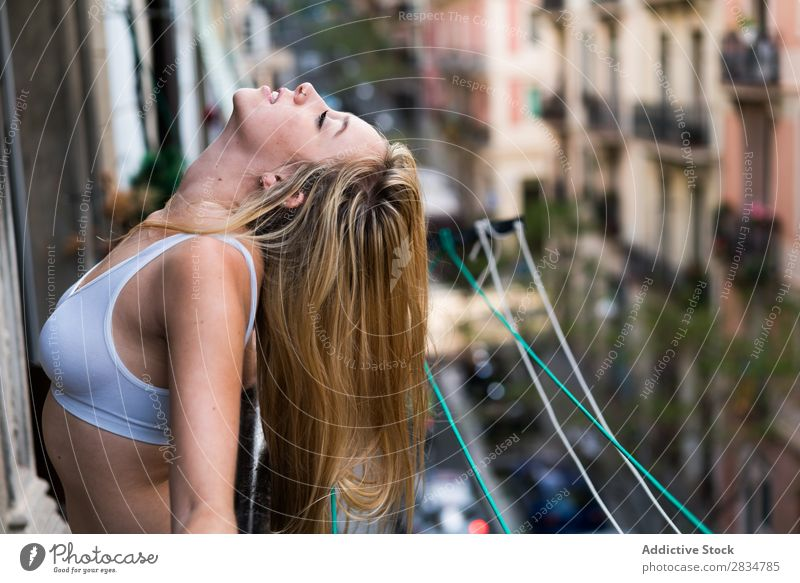 Sexy young woman breathing in the balcony Human being House (Residential Structure) Youth (Young adults) Eroticism Girl Woman Caucasian Happy Home pretty