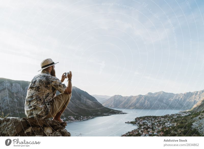 Man taking shots of town Town Mountain River Human being Take Tourist Village Vantage point pathway Landscape Vacation & Travel Nature Tourism Beautiful Valley