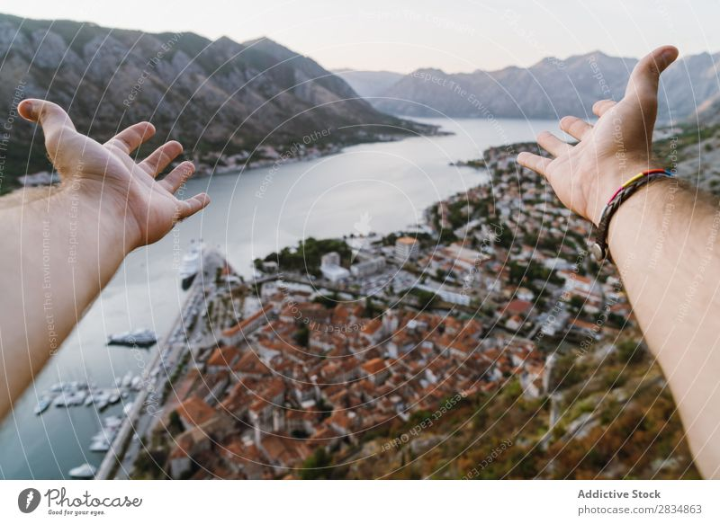 Tourist pulling hands to town Town Mountain River Hand Indicate Human being Village Vantage point pathway Landscape Vacation & Travel Nature Tourism Beautiful