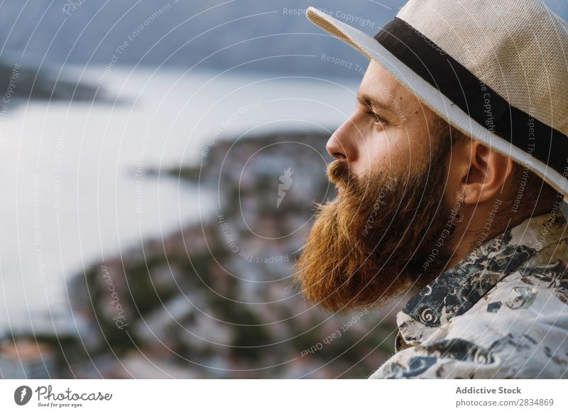 Thoughtful tourist in mountains Town Mountain River Man Human being Tourist Considerate Pensive bearded Village Vantage point pathway Landscape