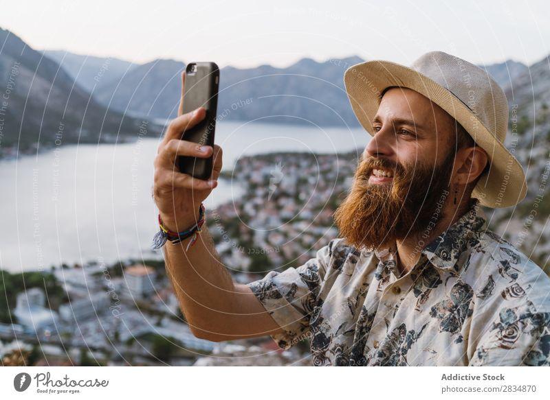 Man browsing phone in mountains Town Mountain River Human being Take Tourist Village