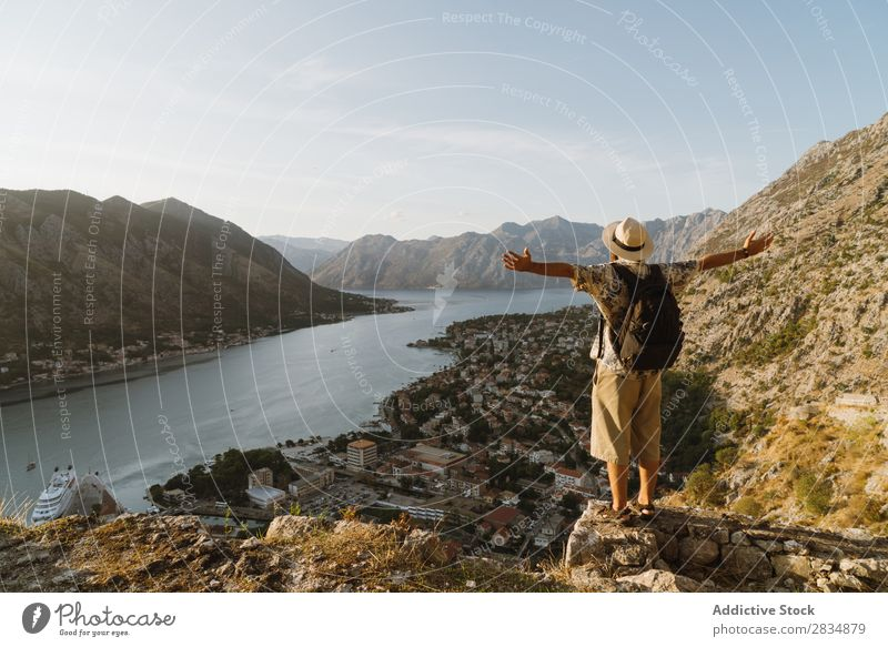 Tourist looking at riverside town Town Mountain River Man Human being Village Vantage point pathway Landscape Vacation & Travel Nature Tourism Beautiful Valley
