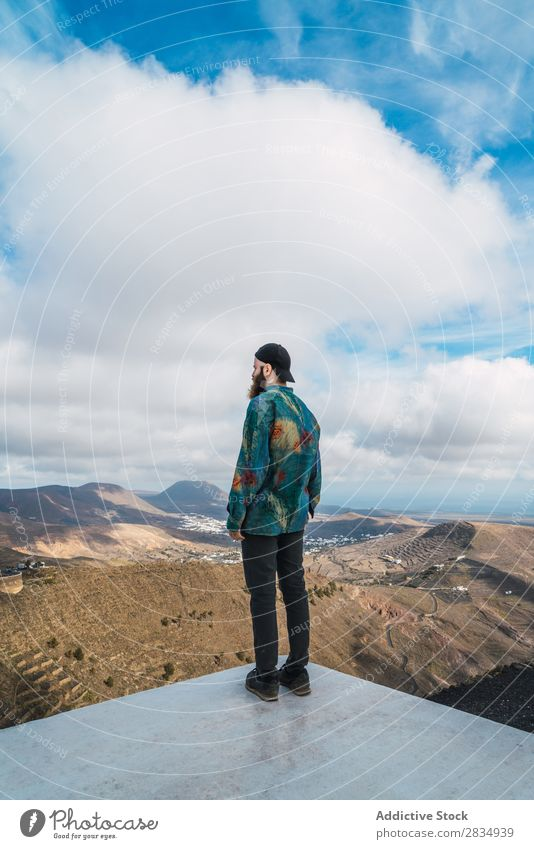 Man on mountain viewpoint Tourist Mountain Clouds Nature Landscape Natural Rock Stone Lanzarote Spain Vantage point Vacation & Travel bearded Tourism Trip