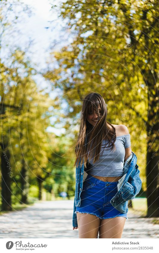 Cheerful woman walking in park Woman Park Autumn Walking Smiling pretty Nature Girl Lifestyle Seasons Yellow Leisure and hobbies Tree Youth (Young adults) Happy