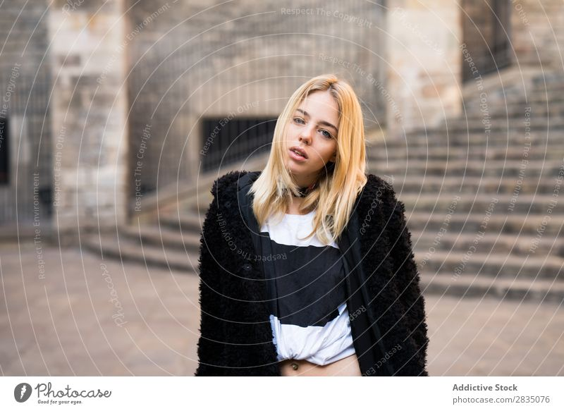 Woman wearing warm clothes looking at camera Easygoing Street City Town Youth (Young adults) Beautiful Looking into the camera Copy Space Beauty Photography