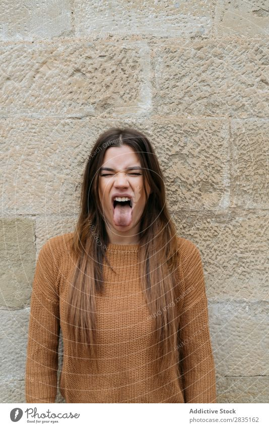 Woman with tongue out near brick wall mouth opened eyes closed Brick Wall (building) Happy Human being Caucasian Youth (Young adults) Beautiful romantic Adults