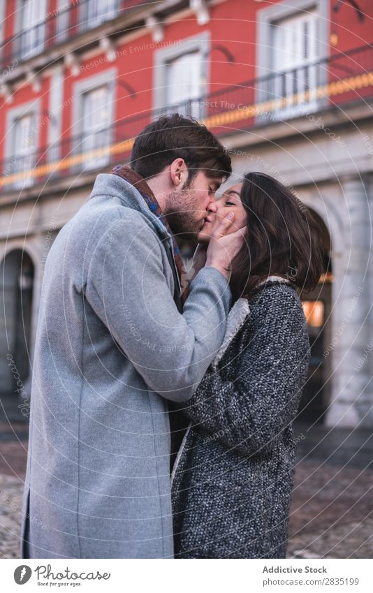Young lovely couple kissing Couple Kissing Embrace Madrid Spain Human being Cheerful