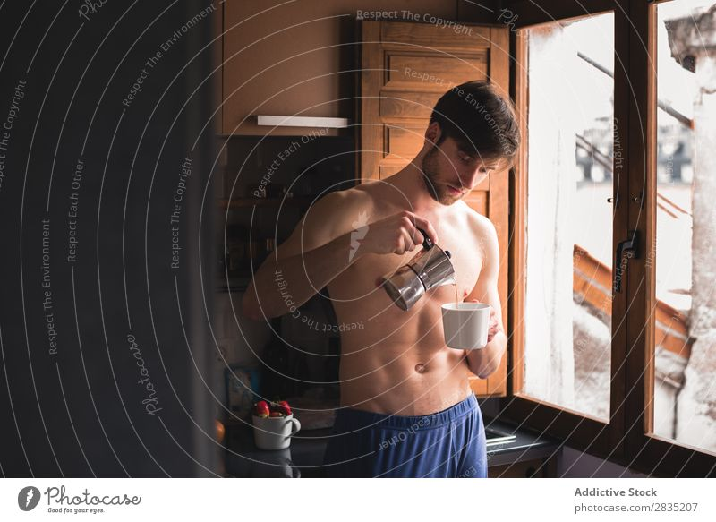 Man pouring a coffee to the mug Cup Morning Filling Considerate Pensive Mug Hot Drinking Think Breakfast Lifestyle Home Portrait photograph Kitchen