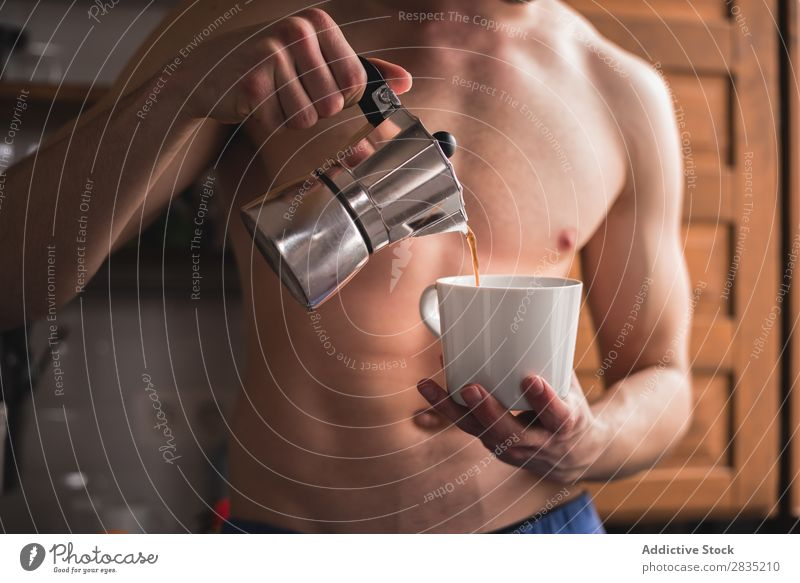 Shirtless man pouring coffee Human being Filling Cup Coffee Man Morning Mug Hot Drinking Breakfast Lifestyle Home Fresh Caffeine Pot Pour Portrait photograph