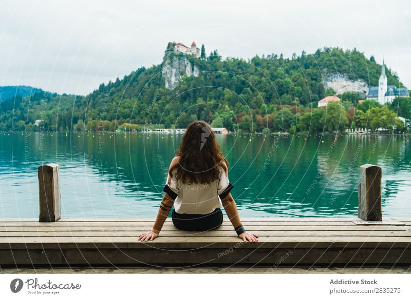 Woman looking at hills on lake - a Royalty Free Stock Photo from