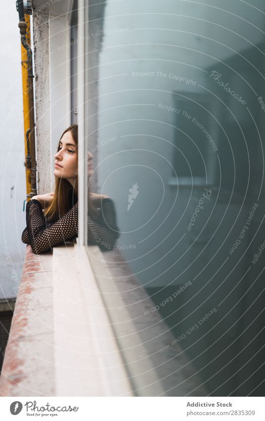 Young model posing in window Woman Window Posture looking out Beauty Photography Contentment Portrait photograph Cheerful Street romantic Dream Flat (apartment)