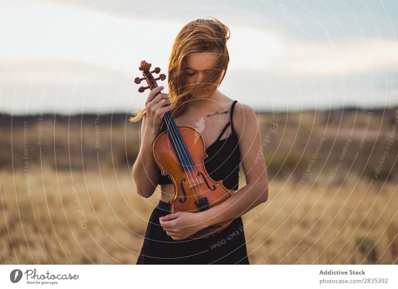Pretty woman with violin on field Woman Violin Music Musician Art Violinist Classical instrument Beautiful Musical Player Performance pretty Field Dress