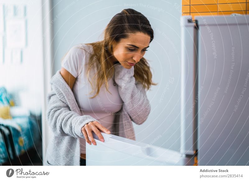 Pretty woman at opened fridge Woman pretty Home Youth (Young adults) Take refrigerator Opening Posture Portrait photograph Beautiful Lifestyle