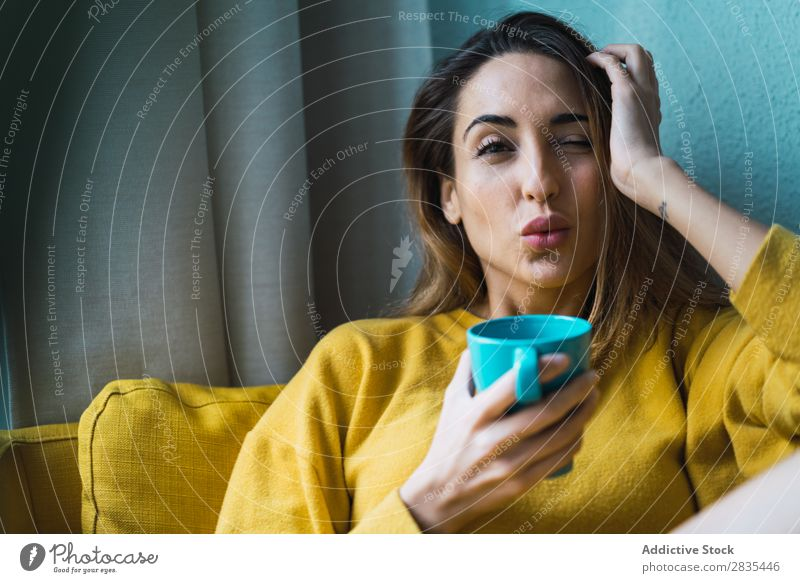 Dreamy woman with cup Woman pretty Home Youth (Young adults) Posture Pensive holding head Cup Hot Drinking Relaxation Considerate Portrait photograph Beautiful
