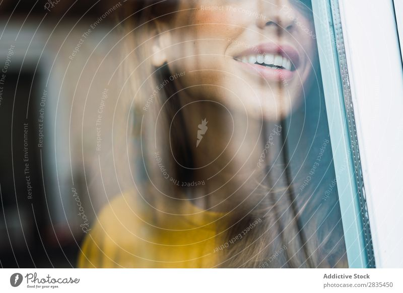 Crop cheerful woman at window Woman pretty Home Youth (Young adults) through window Smiling Cheerful Happy Posture Portrait photograph Beautiful Lifestyle
