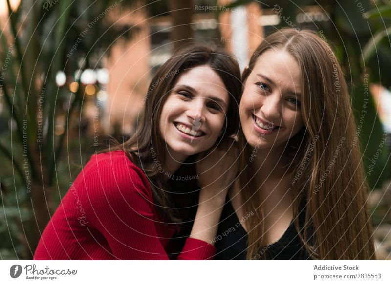 Portrait of two cheerful women Woman pretty Friendship Joy Looking into the camera Together Walking Cheerful Smiling Beautiful Portrait photograph Posture