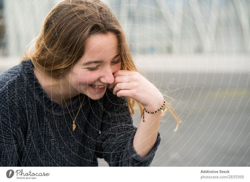 Happy laughing young girl Woman pretty Portrait photograph Laughter Youth (Young adults) Beautiful Looking into the camera Touch Cheek Cheerful Smiling Sweater