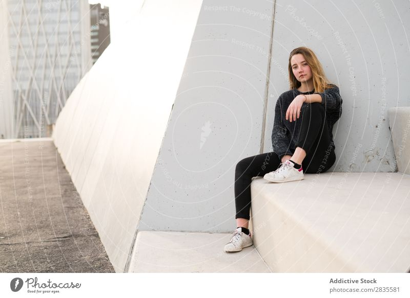Woman sitting on concrete block Sit Concrete Block Stairs Building Dream Considerate Pensive Looking into the camera pretty Youth (Young adults) Beautiful