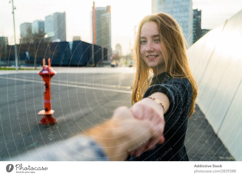 Young cute woman. Follow me concept. follow me gesture smiling cheerful dreamy building hand street city urban looking at camera pretty young beautiful female