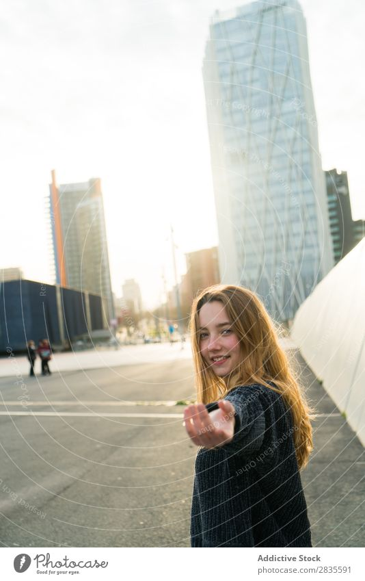 Woman gesturing follow me Gesture Smiling Cheerful Dream Building Hand Street City Town Looking into the camera pretty Youth (Young adults) Beautiful Sweater