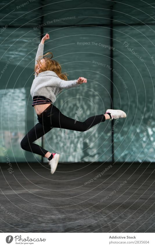 Cheerful jumping woman Woman Running Jump Joy pretty Happy Easygoing Guest Smiling Happiness Youth (Young adults) Beautiful Sweater Girl Beauty Photography